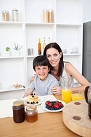 Portrait of a mother and her son having breakfast in the kitchen
