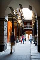 Pedestrians in a passageway, Stralsund, Germany