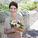 Mature bride holding bouquet (thumbnail)