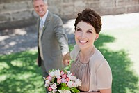 Mature bride and groom smiling