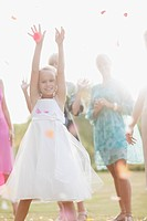 Flower girl catching bouquet at wedding reception