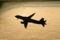 Shadow of airplane flying into land at Hurghada Airport, Hurghada, Red Sea, Egypt.