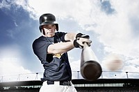 Baseball player swinging baseball bat