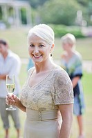 Mature bride drinking champagne