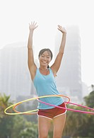 Woman twirling hula hoops