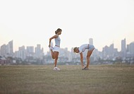 Women stretching park before exercise