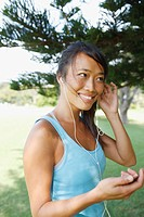 Woman listening to mp3 player