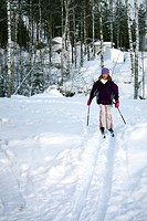 Ten year old girl cross_country skiing, Finland, Scandinavia, Europe