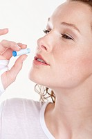 Close_up of a woman taking Homeopathic medicine