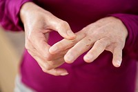 Close_up of a woman suffering from finger pain