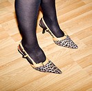 Woman wearing high heeled leopard skin stilettos