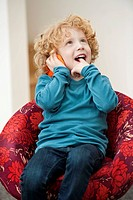 Boy talking on a mobile phone