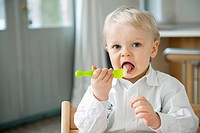 Portrait of a boy eating with a fork (thumbnail)