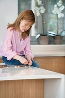 Girl sitting on a kitchen counter