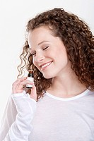 Woman smelling aromatherapy oil