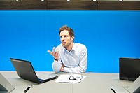 Businessman working on a laptop in a conference room (thumbnail)