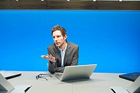 Businessman working on a laptop in a conference room