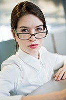 Portrait of a businesswoman looking over eyeglasses