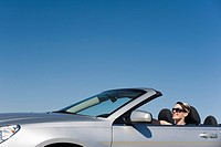 Woman out for pleasure drive in convertible