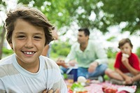 Boy having picnic with family, portrait