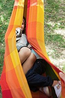 Children hiding together in hammock