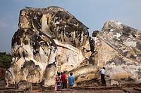 Thailand, Ayutthaya, Ayutthaya Historical Park, Wat Lokaya Sutha, Monk Preying at Giant Reclining Buddha