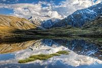 Mt Tyndall, reflection in tarn, Cascade Saddle, Mount Aspiring National Park, Otago, New Zealand (January 2010)