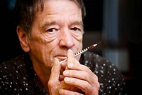Man with small hypodermic needle