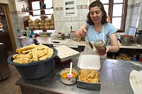Europe, Greece, Peloponnese, Arkadia region, Stemnitsa village, To Arkadito, greek cakes production, diples, have to be eaten with honey