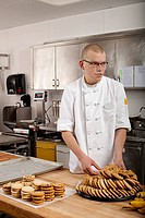 Male chef baking cookies in commercial kitchen