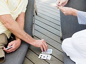 People playing cards outdoors