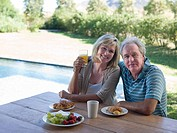 Couple having breakfast in garden