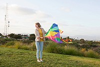 Young woman in a field with a kite