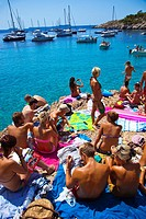 Group of people on the beach. Cala Salada beach. Santa Agnés de Corona. Ibiza. Balearic Islands. Spain