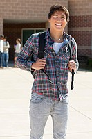 Male high school student outside school building (thumbnail)