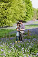 Young couple in a field of bluebells