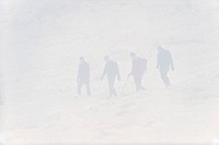 Four hikers in mist, on moorland in snow, Peak District, Derbyshire, England, winter