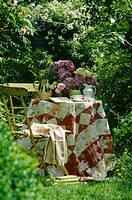 Still_Life of patchwork cloth on garden table