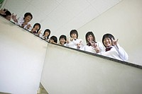 Students smiling from school staircase