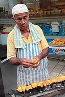 Malaysia, Kuala Lumpur, Chinatown, cook grilling chicken satay,