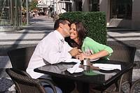 Couple kissing in lincoln road Miami Beach