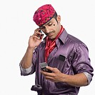 Actor portraying a tapori using mobile phones