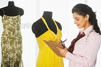 Female dress designer working in a boutique