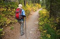 Woman hiker on Saint Mary Lake trail, Glacier National Park