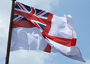 Royal Navy white ensign as flown from the back of a warship in the UK