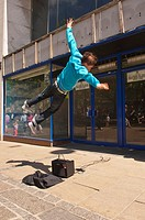 A Free Runner busking and showing movement in the streets of Norwich , Norfolk , England , Great Britain , Uk