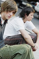 Close_up of two teenage boys sitting together