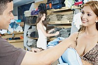 Close_up of a young couple in a clothing store