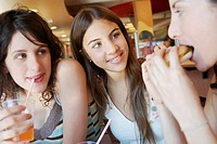 Close_up of three young women in a restaurant