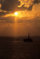Offshore Oil Drilling Rig at Sunset
